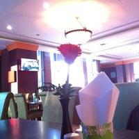 Photo taken at Kanmanee Palace Hotel by Juu W. on 1/16/2015