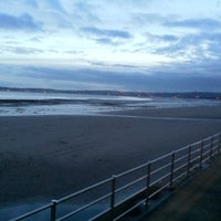 Photo taken at Swansea Bay Beach by Dafydd V. on 1/15/2013