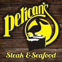 Photo taken at Pelican's Steak & Seafood by Leo M. on 6/18/2014