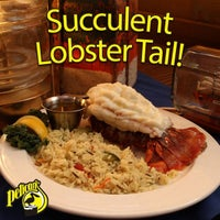 Photo taken at Pelican's Steak & Seafood by Leo M. on 5/18/2014