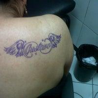 Photo taken at Dakar tattoo by Mary Ibetts B. on 8/4/2013