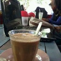 Photo taken at enjoy cafe by E J A. on 8/29/2012