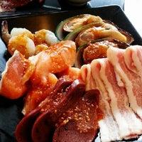 Photo taken at AKA USHI - Japanese Grill & Sushi by Pinky P. on 6/4/2013