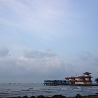 Photo taken at Pantai Pasir Kencana by Wisnu W. on 3/2/2014