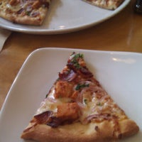 Photo taken at California Pizza Kitchen by Caleb G. on 3/21/2013