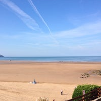 Photo taken at Woolacombe Beach by James R. on 9/8/2014