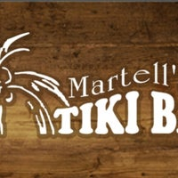 Photo taken at Martell's Tiki Bar by David M. on 5/26/2013