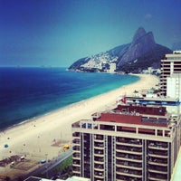 Photo taken at Ipanema Beach by M P. on 5/27/2013