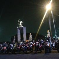 Photo taken at Patung Panahan Senayan by Nofan A. on 11/6/2013