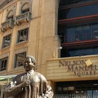 Photo taken at Nelson Mandela Square by Stephen L. on 9/4/2013