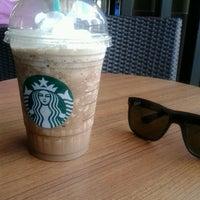 Photo taken at Starbucks by Huseyin H. on 6/22/2013