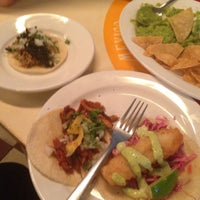 Photo taken at Tacombi Café El Presidente by Chez O. on 7/17/2015