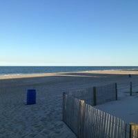 Photo taken at 124 Street Beach by Melanie C. on 9/19/2013