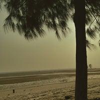 Photo taken at Pantai Kelanang by Redhair K. on 7/28/2013