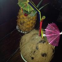 Photo taken at Tiki bar by Daniiela R. on 7/12/2014