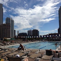 Photo taken at East Bank Club Pool Deck by M & M. on 7/24/2013
