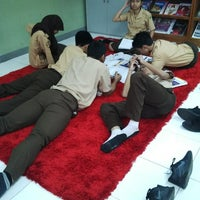Photo taken at SMAN 61 Jakarta by irene p. on 5/7/2014