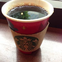 Photo taken at Starbucks by Masahiro on 12/3/2012