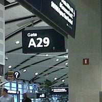 Photo taken at Gate A29 by Adrian G. on 8/12/2013