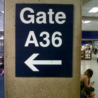 Photo taken at Gate A36 by Adrian G. on 7/1/2013