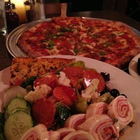 Photo taken at Pesto's Gourmet Pizza & Wine Bar by Mario R. on 6/3/2013