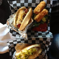 Photo taken at Biker Jim's Gourmet Dogs by Emilie Z. on 5/31/2013