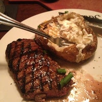Photo taken at Firebirds Wood Fired Grill by Marcus M. on 6/1/2013