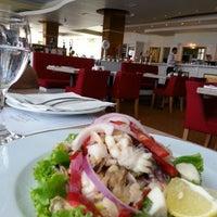 Photo taken at MiniMax Restaurant by Kiriakos R. on 7/14/2013