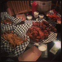 Photo taken at Boneheads Wing Bar by Benny S. on 6/15/2013
