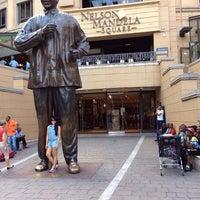 Photo taken at Nelson Mandela Square by Jill I. on 1/3/2014