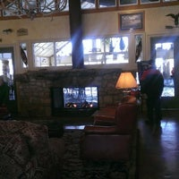Photo taken at Brushey Creek Clubhouse - Big Cedar Lodge by Christopher D. on 2/13/2014