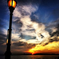 Photo taken at Battery Park by Atsuya S. on 11/24/2012