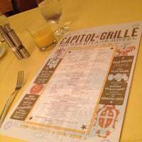 Photo taken at Capitol Grille by Shawn K. on 7/4/2014