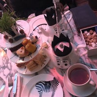 Photo taken at Madhatter's Tea Party by Rana A. on 2/15/2018