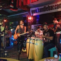 Photo taken at Handlebar Bar and Grill by Marizel S. on 7/19/2013