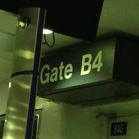 Photo taken at Gate B4 by Alex L. on 6/19/2013