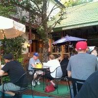 Photo taken at Three Monkeys Café by Michele A. on 9/20/2012