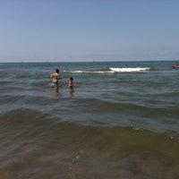 Photo taken at Lido Beach Spiaggia Libera Lido Di Camaiore by Stefano C. on 6/15/2013