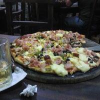 Photo taken at Pizzería El Sabor de Los 4 Quesos by Maria Luisa O. on 3/7/2013