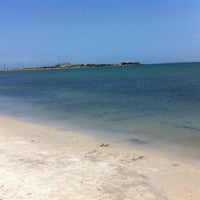 Photo taken at Playa El Oasis by Ismael F. on 6/16/2013