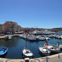 Photo taken at Port de Saint-Tropez by Jean-Camille V. on 5/12/2013