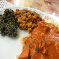 Photo taken at Haveli Indian Cuisine by Sarah K. on 7/13/2013