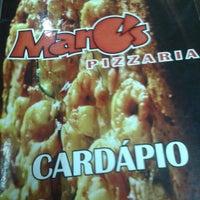 Photo taken at Mano's Fast Food e Tele Entrega by Daniel M. on 7/31/2013