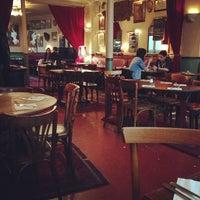 Photo taken at Café de l'Industrie by Eugene T. on 5/2/2013
