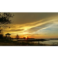 Photo taken at Jerudong Beach by Kamarul A. on 4/18/2015