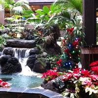 Photo taken at Disney's Polynesian Village Resort by j r. on 12/29/2012