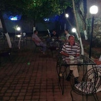 Photo taken at Saklı Bahçe Nargile Cafe by Hakan E. on 8/3/2013