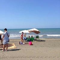 Photo taken at Marina Velca Beach by Monica L. on 7/5/2014