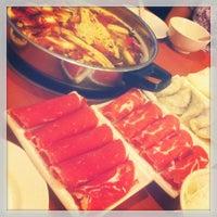 Photo taken at La Mei Zi Restaurant (辣妹子火锅) by Chun W. on 4/14/2013
