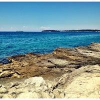 Photo taken at Beach Rovinj by Miro on 6/20/2013